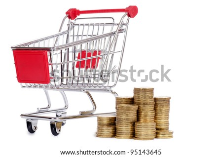 Shopping cart and coins isolated on white