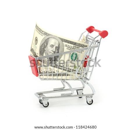 Shopping cart and dollars - stock photo