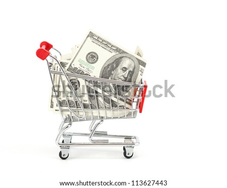 Shopping cart and dollars isolated on a white