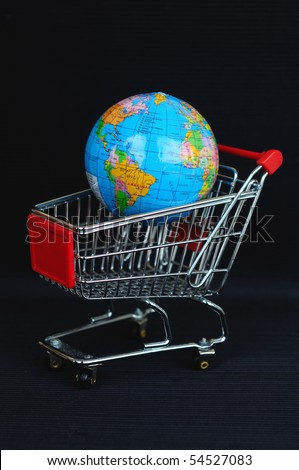 shopping cart and globe on black background