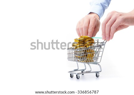Shopping cart and gold coins