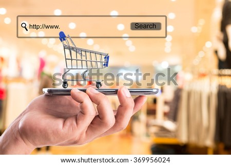shopping cart and money with your e-commerce. - stock photo