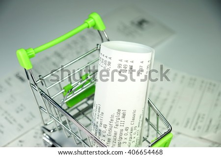 Shopping cart and sales receipt - stock photo