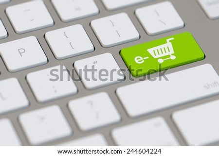 Shopping cart as symbol for e-Commerce online at computer (3D Rendering) - stock photo