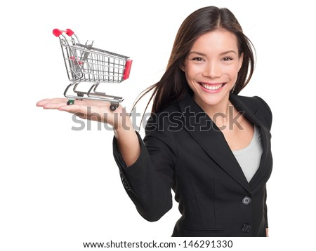 Shopping cart - business woman shopper. Woman showing holding mini shopping cart. Happy shopping or consumer loan concept with young female professional isolated on white background. - stock photo