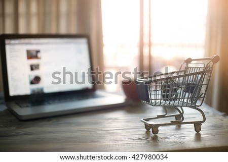 Shopping Cart concept with shopping online at morning time and soft focus. - stock photo