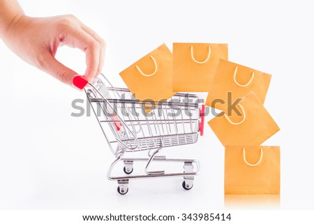 Shopping cart filled with shopping bags isolate on white background