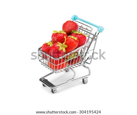 Shopping cart filled with strawberries on pure white background. Healthy shopping and eating concept. - stock photo