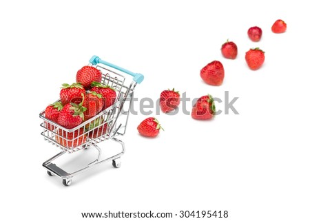 Shopping cart filled with strawberries on pure white background with some strawberries fallen out. Healthy shopping and eating concept. - stock photo