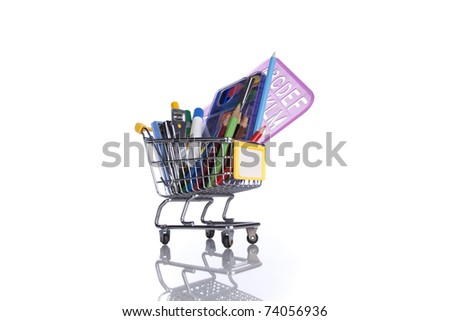 shopping cart full of education material (selective focus)