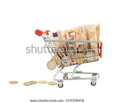 Shopping cart full of euro notes and coins, isolated over the white background - stock photo