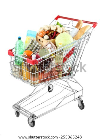 Shopping cart full with various groceries isolated on white  - stock photo