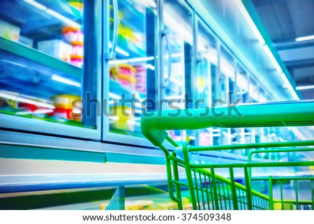 Shopping cart in a supermarket - stock photo