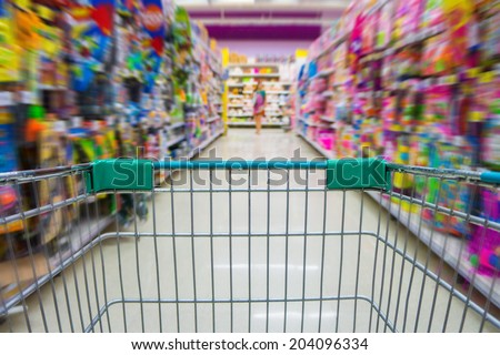 Shopping cart in toys department store - stock photo