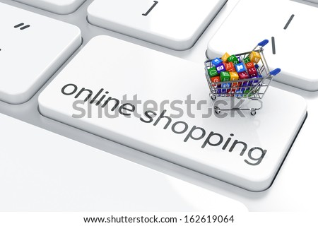 Shopping cart isolated on the computer keyboard. Online shopping concept  - stock photo