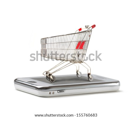 shopping cart on a closed laptop