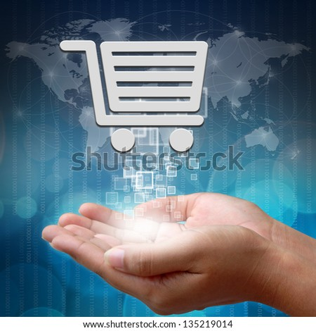 Shopping cart on hand - stock photo