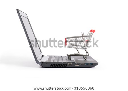 Shopping cart on laptop on isolated white background, side view