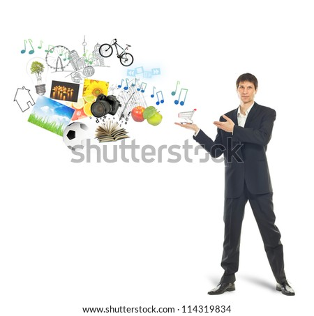 Shopping cart on palm of businessman and goods. On white background with small shadow
