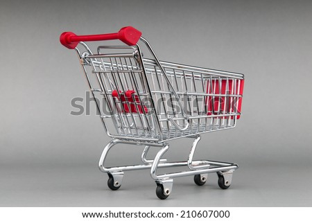 Shopping cart on seamless background
