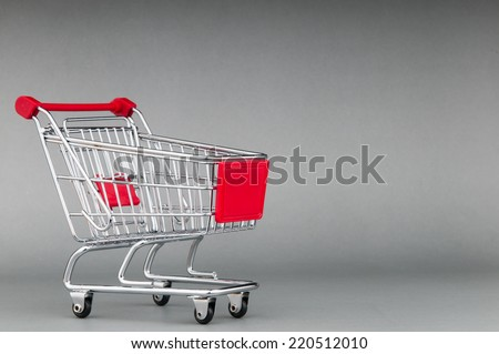 Shopping cart on seamless background - stock photo