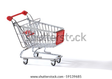 shopping cart throwing a long shadow on white background