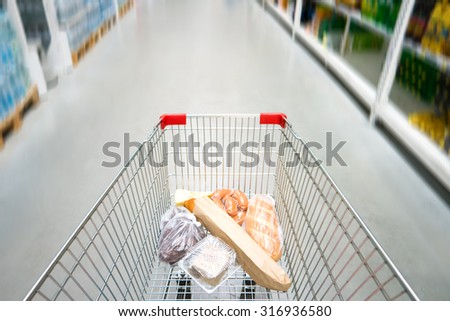 Shopping cart, trolley in a big supermarket with no people - stock photo
