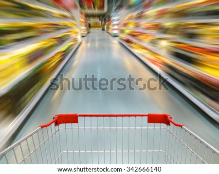 Shopping Cart View in Supermarket Aisle motion blur - stock photo