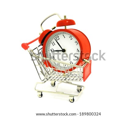 Shopping Cart with Alarm Clock - stock photo