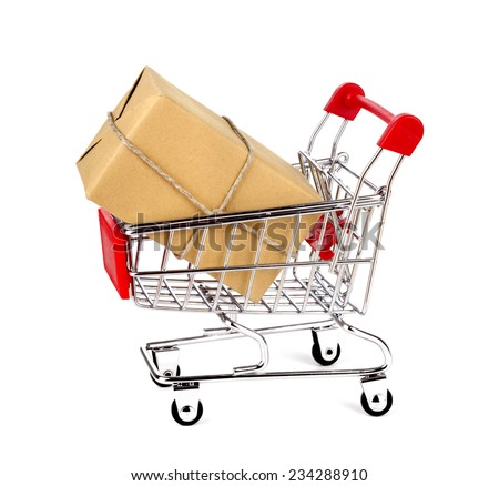 Shopping cart with box on white isolated background. - stock photo