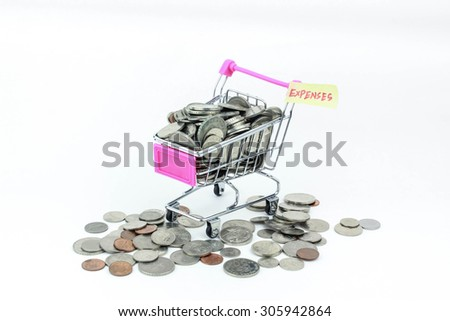 Shopping cart with coins, isolated - expenses concept - stock photo