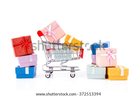 Shopping Cart With Colorful Gifts Box On White - stock photo