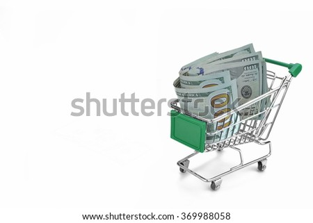Shopping Cart With Dollar Cash And Green Advertising Display Isolated On White Background, Closeup, Buyer Activity Concept