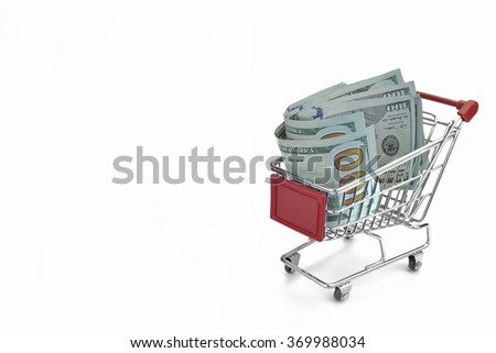 Shopping Cart With Dollar Cash And Red Advertising Display Isolated On White Background, Closeup, Buyer Activity Concept