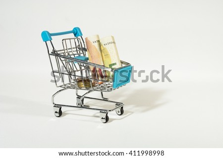 Shopping Cart with Euro Bills and Coins Isolated on White Background