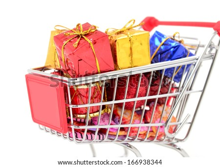 Shopping cart with gifts new year and Christmas gifts, isolated on white background