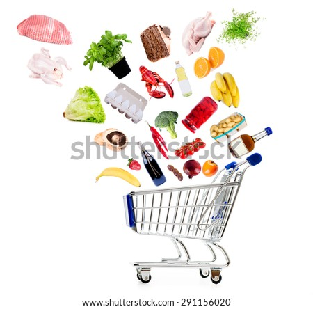 Shopping cart with grocery goods isolated on white - stock photo