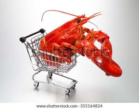 Shopping cart with lobster - stock photo