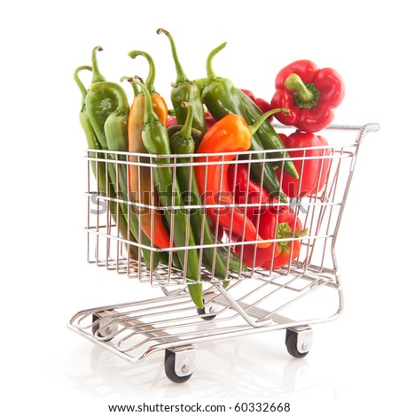 shopping cart with paprika and pepper isolated over white