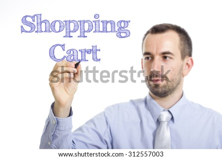 Shopping Cart - Young businessman writing blue text on transparent surface