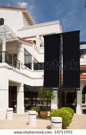 Shopping center with black blank sign-age for customization