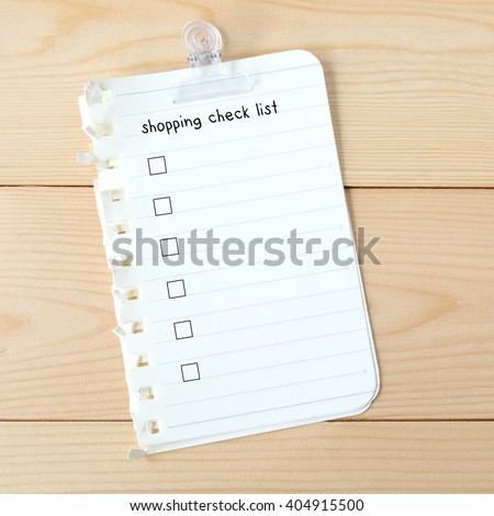 Shopping check list on blank paper, background, business  - stock photo