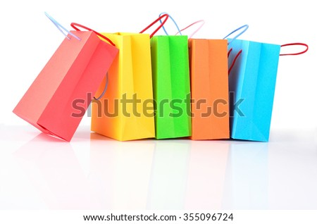 Shopping colorful sale paper bags close-up on a white background