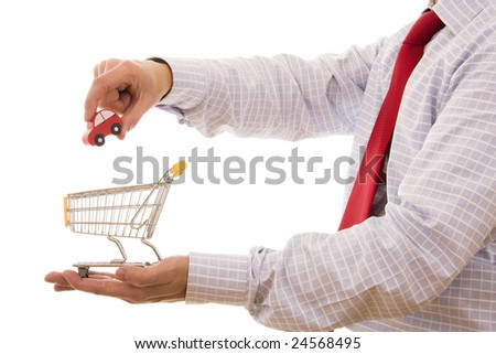 Shopping concept - Hand putting a car on a trolley shop