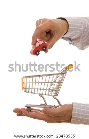 Shopping concept - Man putting a car on a trolley shopping