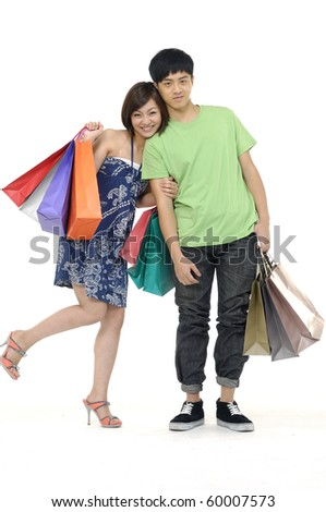 Shopping couple smiling. Isolated