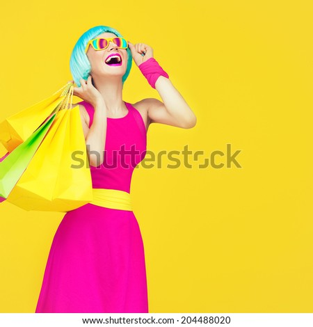 Shopping crazy girl - stock photo