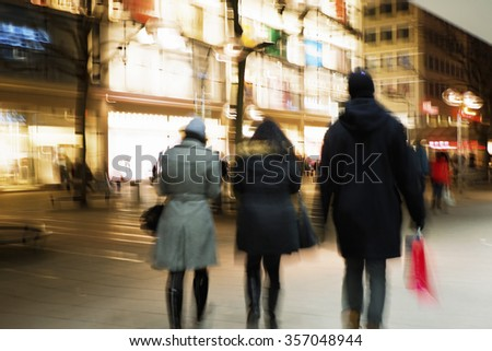 Shopping crowd walking on sidewalk