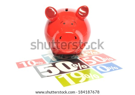 Shopping discount - Red piggy bank on multicolored newspaper advertisements - stock photo