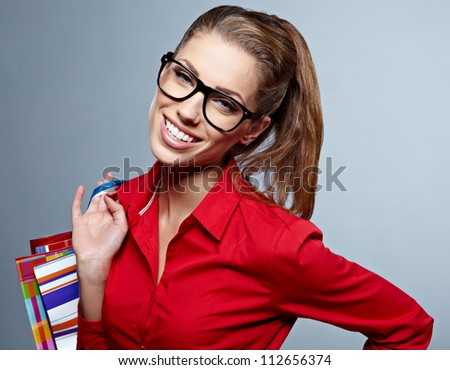 Shopping. Excited woman shopper with a big grin and a lot of shopping bags - stock photo